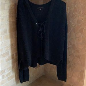 Knit black sweater with lace-up front
